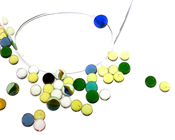 Photograph of colored marbles on a white background